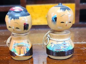 Vintage hand-painted wooden boy and girl dolls w actuated heads