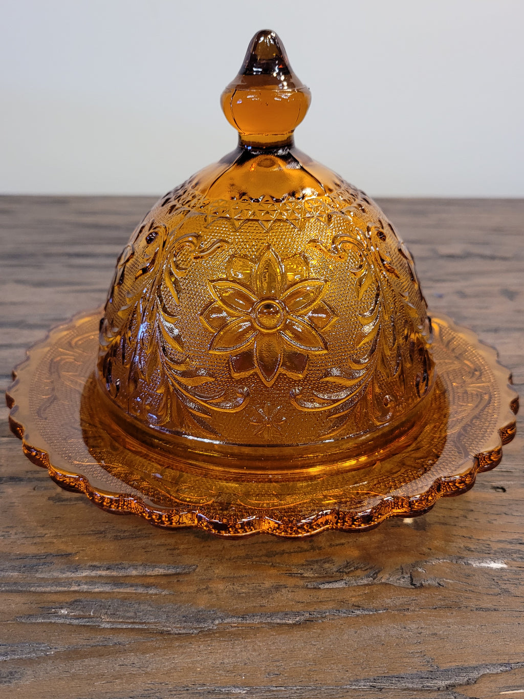 Vintage daisy pattern amber glass covered glass candy / butter dish
