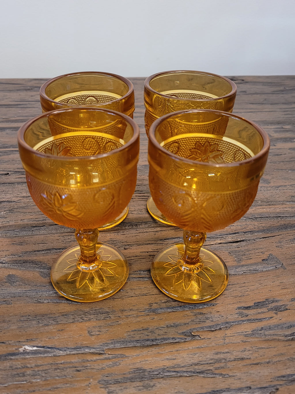 Vintage daisy pattern amber glass cordial glasses, set of 4