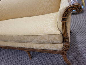 Antique sofa, solid carved oak with golden upholstery