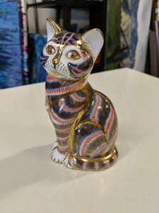 Royal Crown Derby porcelain cat in gold, blue and red