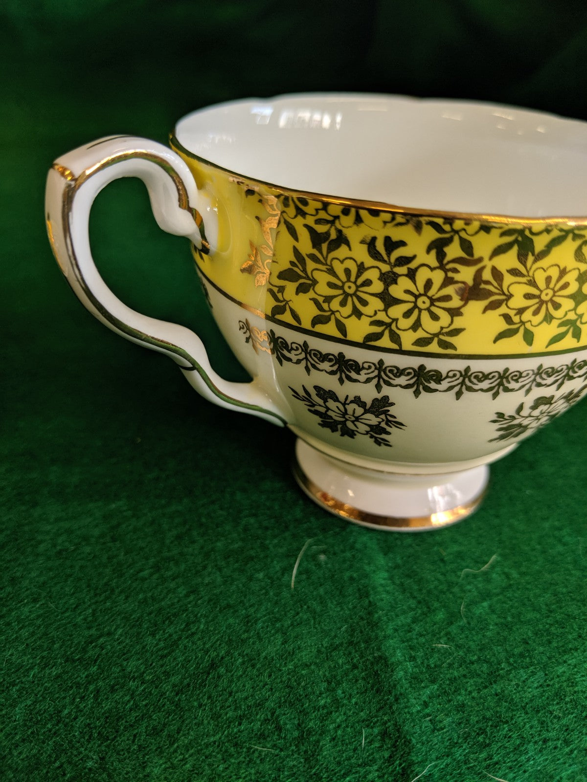 Vintage Royal Stafford tea cup and saucer, cream, yellow w gold