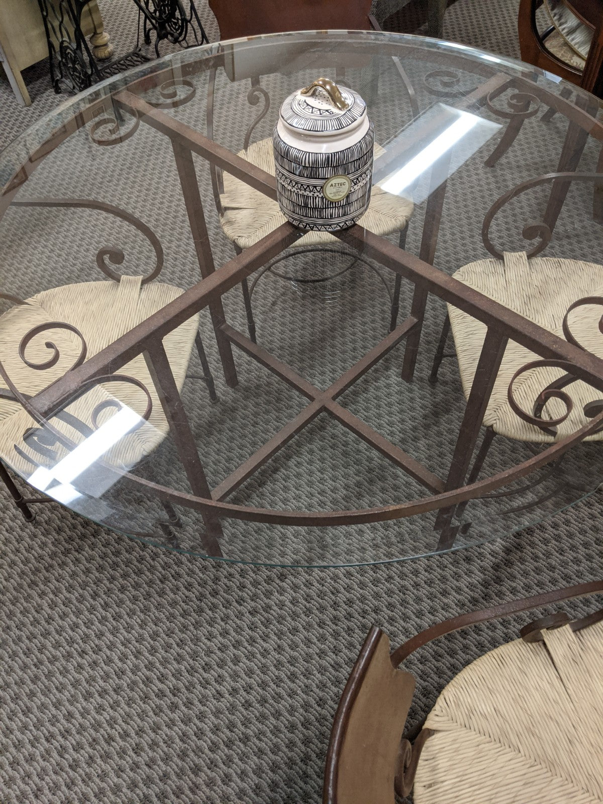 Round glass-top breakfast table w 4 metal-framed strawgrass chairs