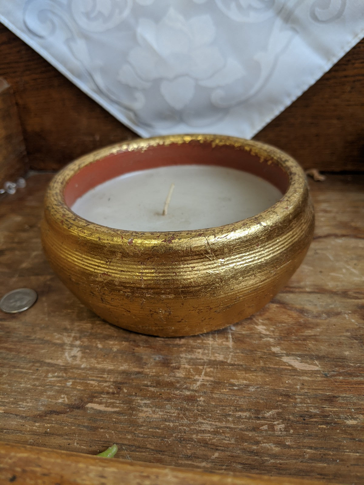 Gold-painted terra cotta candle