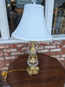 Glass and brass table lamp with white shade