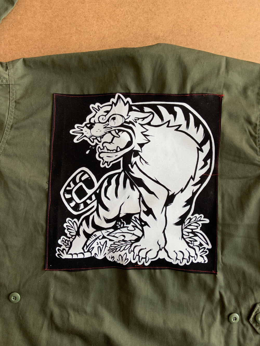 Levitzo- Crouching Tiger Green Military Jacket: White Print on Black