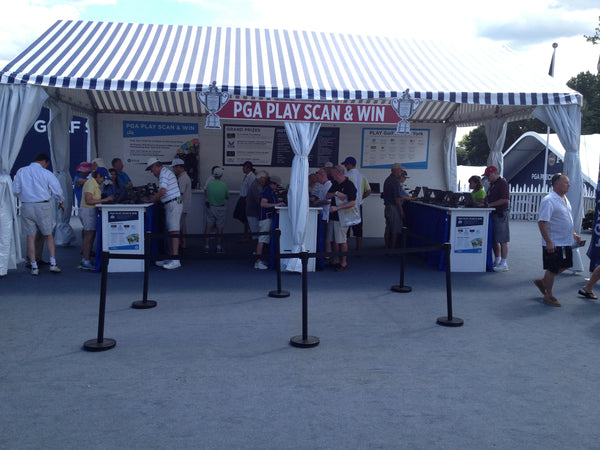 Black retractable belt barriers concession stand