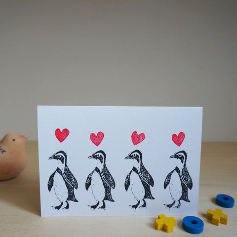 Marching penguin greetings card