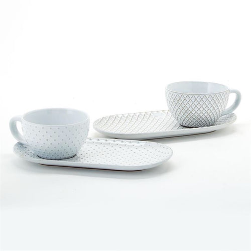 Two tea cup and saucer set