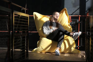 Girl Sitting in Maize Yellow Fatboy Original Slim Velvet Bean Bag Chair