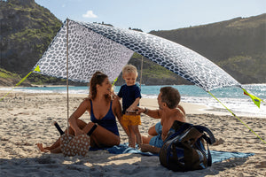 Family Under Fatboy Miasun x Vilebrequin Sun Shade on Beach