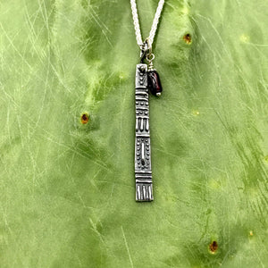 sterling silver geometrically textured long thin bar pendant with chain and garnet bead charm