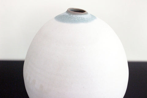 Green and white belly vase