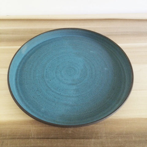 Large ceramic decorative plate in aqua and chocolate brown