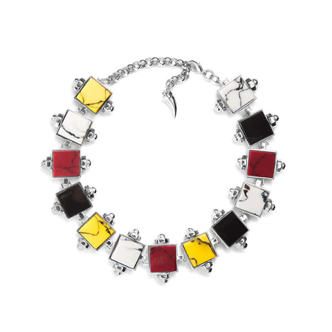 Hematite plated statement necklace with beautifully rich red, yellow and white marble and black resin cubes.   This signature piece will allow you to make a bold statement this season. Its luxurious yet extravagant shape would be a welcome addition to your look. Clever and tasteful selection of colours will suit any outfit.