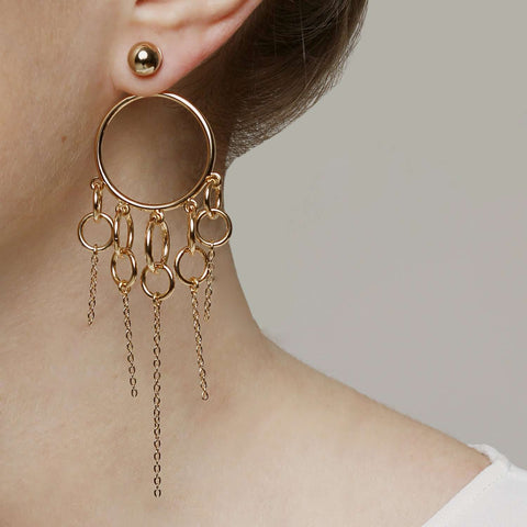 Discover yellow gold plated metal hoop earrings.