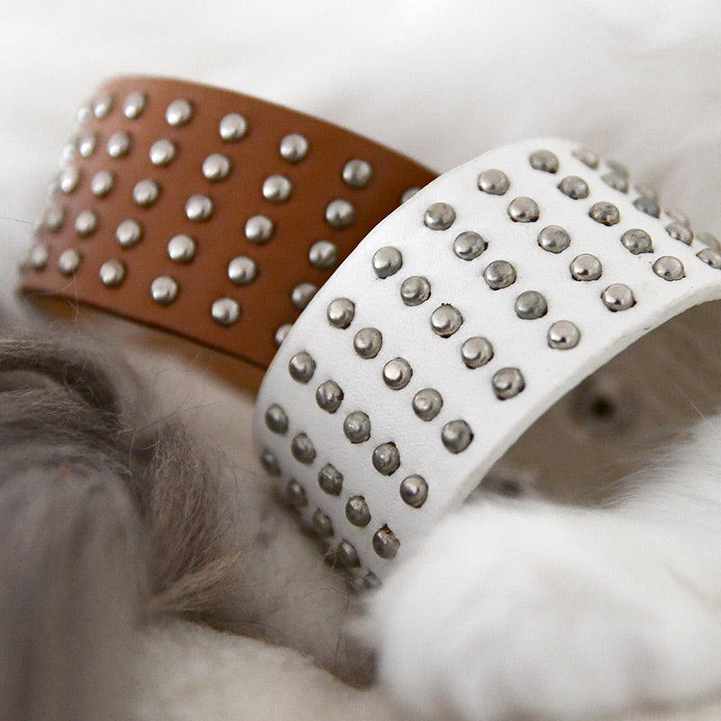 Wide bracelet with metal rivets