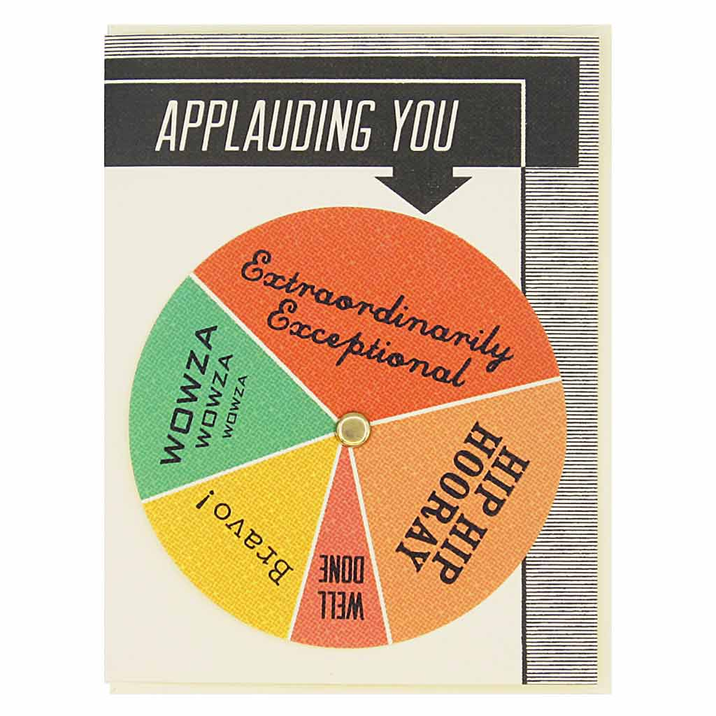 "Turn the wheel to find the appropriate exclamation. Text on top says ""Applauding You"" and choices on the wheels are things like... hip hip hooray and extraordinarily exceptional. Card measures 4¼"" x 5½"", comes with a cream envelope & is blank inside."