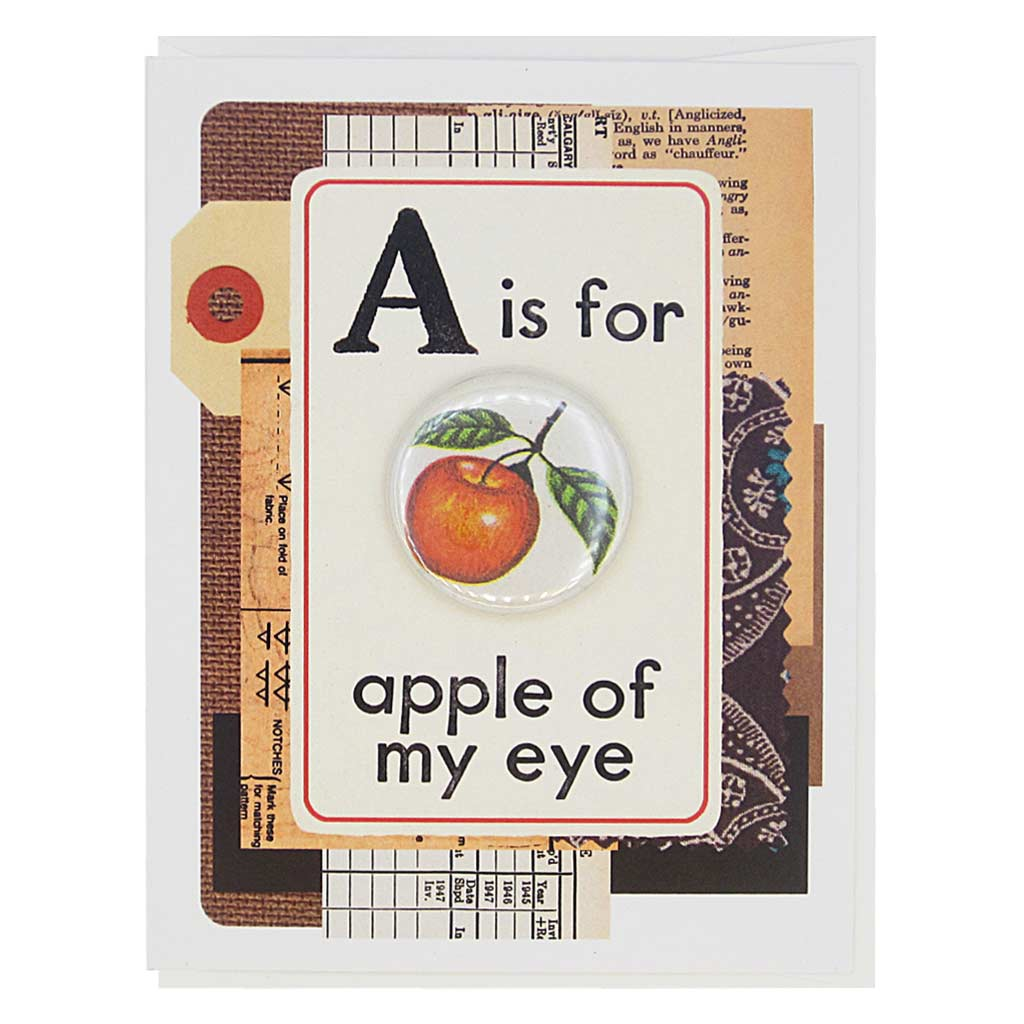 "This card looks like a vintage flashcard and says A is Apple of My Eye. It features a 1½"" button of a reef knot that can be taken off and worn by the recipient. Card measures 4¼"" x 5½"", comes with a white envelope & is blank inside. Designed by The Regional Assembly of Text."