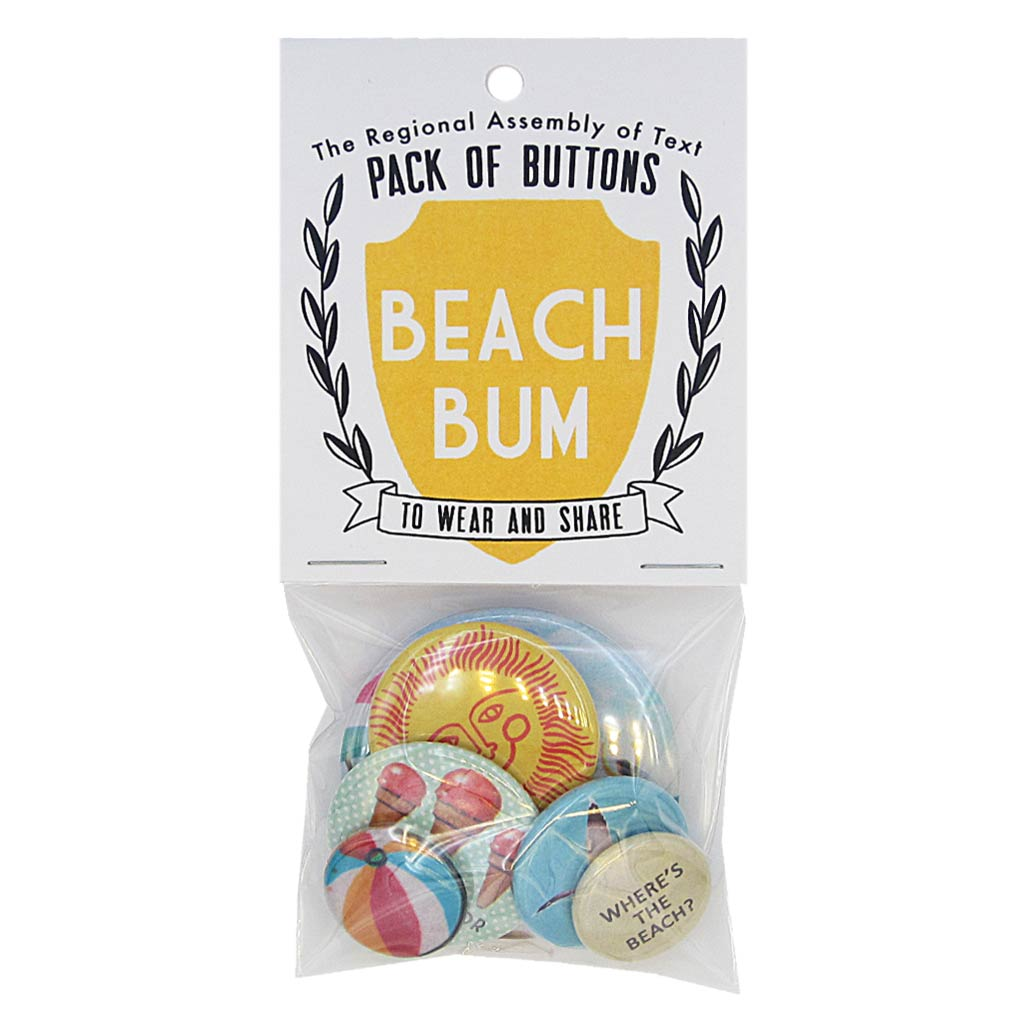 "This pack of buttons has 6 buttons of varying sizes. Button images include: ice cream cones, beach ball, sun, seagull, beach umbrella and a button with the text ""Where's the beach?"" Designed by The Regional Assembly of Text"