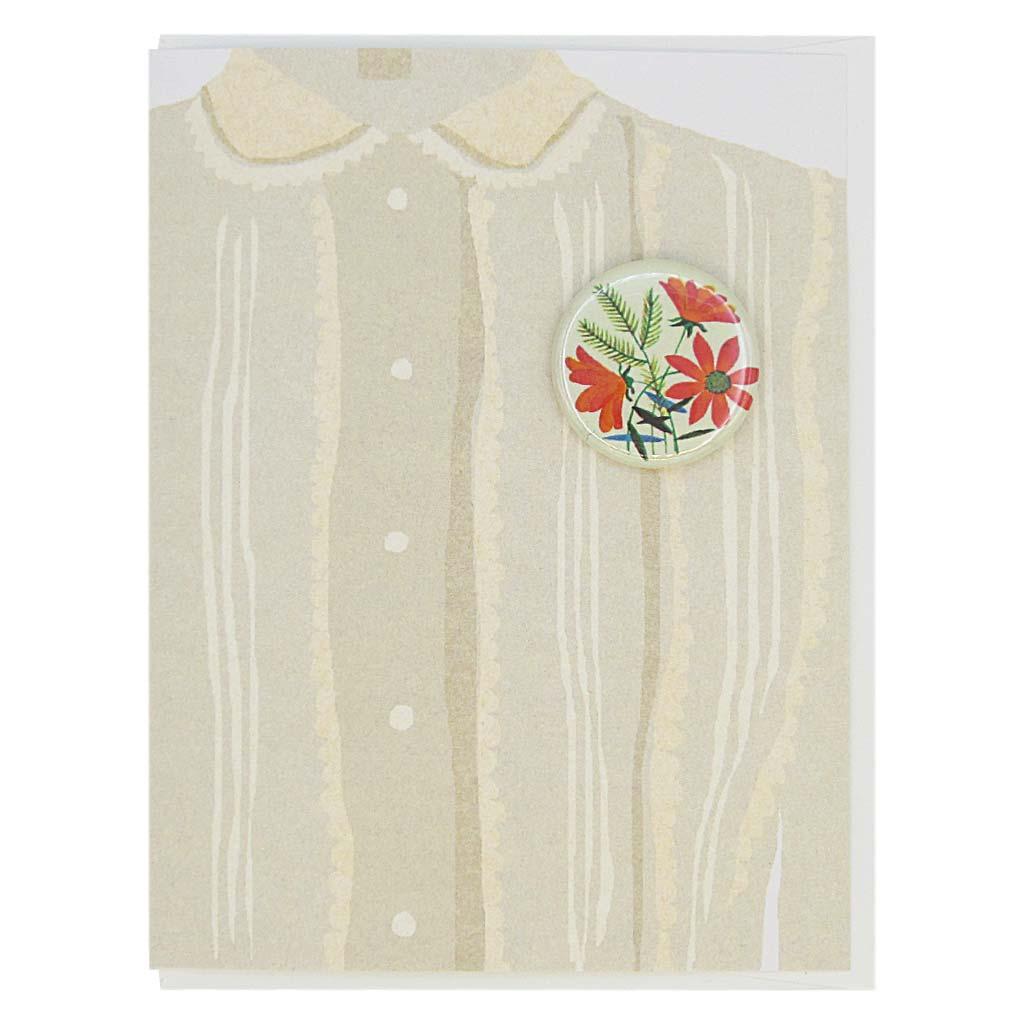 "This greeting card is a collage of a pretty taupe blouse with a button of bouquet of orange flowers on the chest.  The button is 1¼"" and can be taken off and proudly worn by the recipient. Card measures 4¼"" x 5½"", comes with a white envelope & is blank inside. Designed by The Regional Assembly of Text."