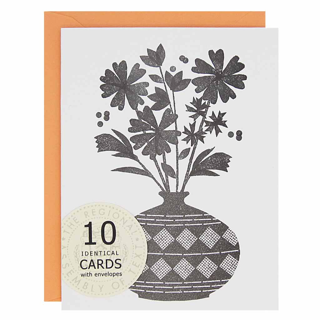 "This lovely bouquet is perfect for any occasion: thank you, get well, congratulations, just to name a few. Boxed set contains 10 identical cards with a black and white lino cut inspired image of a bouquet of flowers in a vase(blank inside) & 10 coral envelopes. Cards measure 4¼"" x 5½""."
