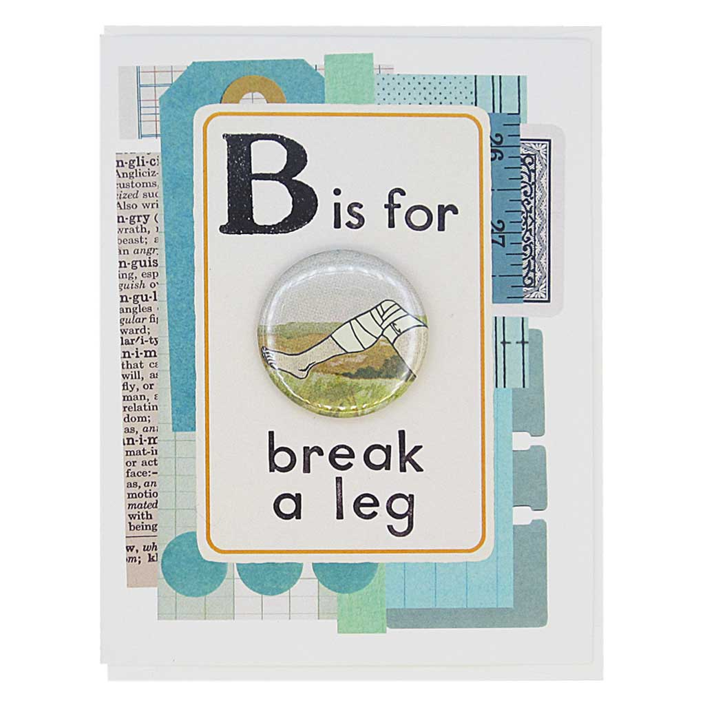 "This good luck greeting card looks like a vintage flashcard and says B is for Break a Leg. It features a 1½"" button of a broken leg that can be taken off and worn by the recipient. Card measures 4¼"" x 5½"", comes with a white envelope & is blank inside. Designed by The Regional Assembly of Text."