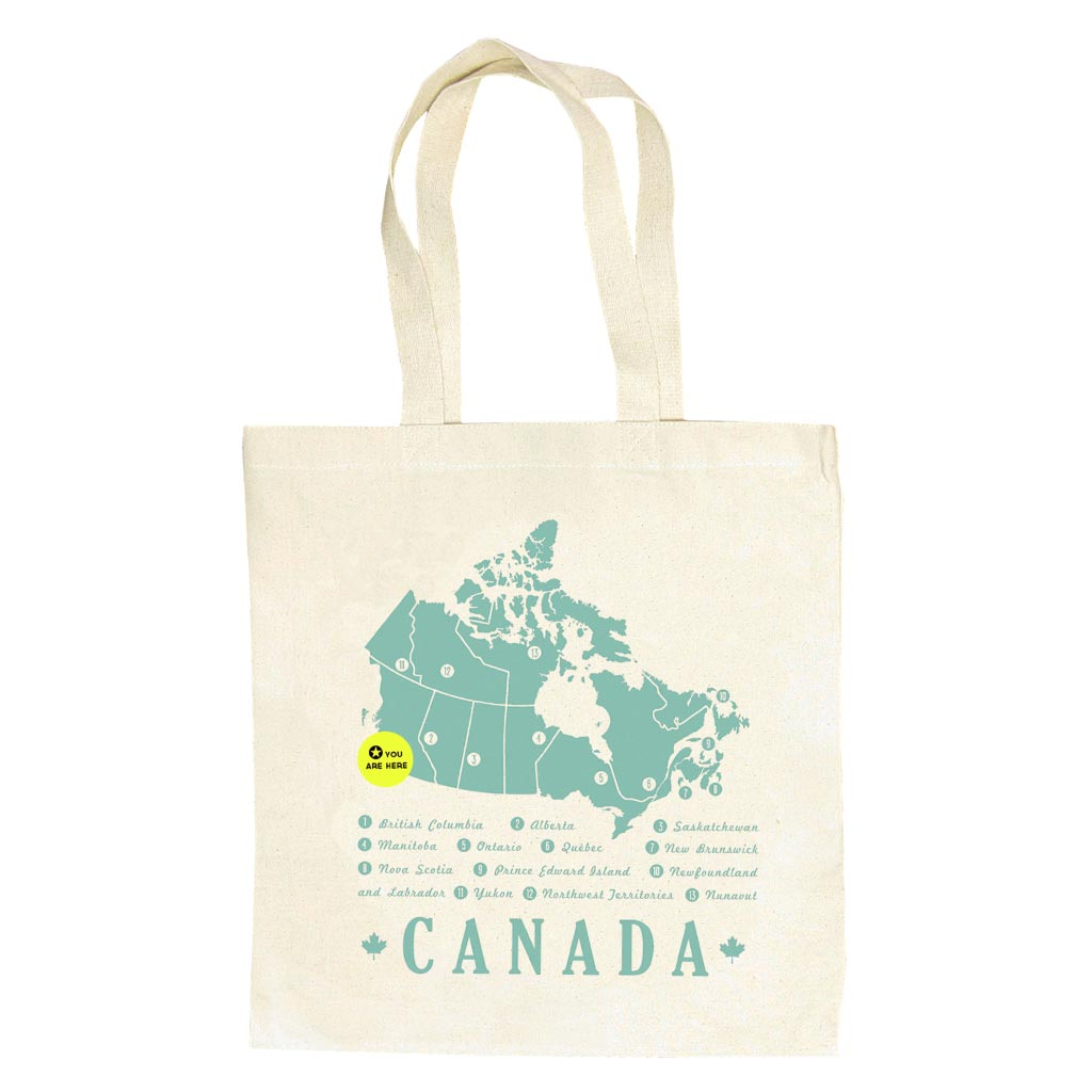 "A durable, heavy weight canvas bag to tote around all your books and groceries. Features a minty green map of Canada and a 'You Are Here' button that can be taken off and moved around the country. Measures 14"" x 16"" with a sturdy handle."