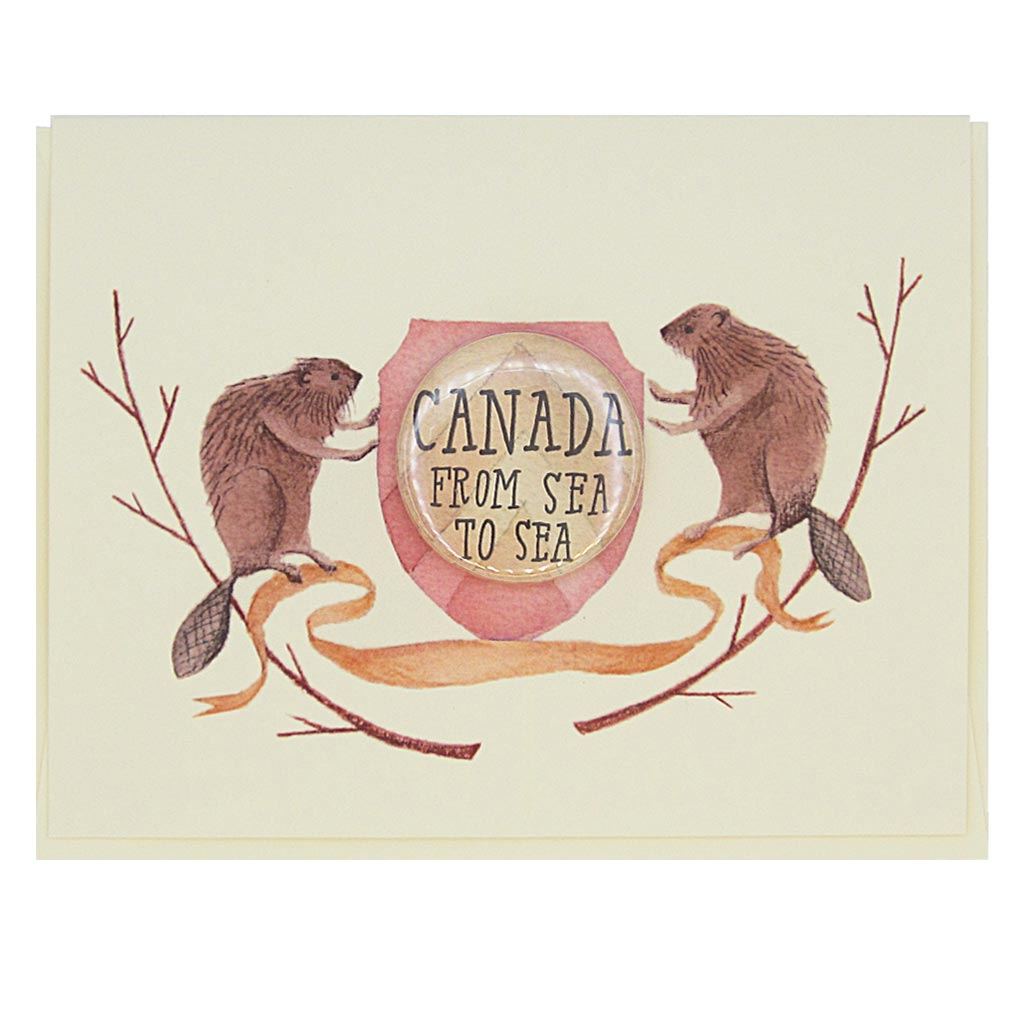 "This beautiful greeting card features a watercolour painting of two beavers on either side of a crest. There is a 1½"" button in the middle of the crest that reads 'Canada, from sea to sea'. The button can be taken off and worn by the recipient. Card measures 4¼"" x 5½"", comes with a cream envelope & is blank inside. Designed by The Regional Assembly of Text."
