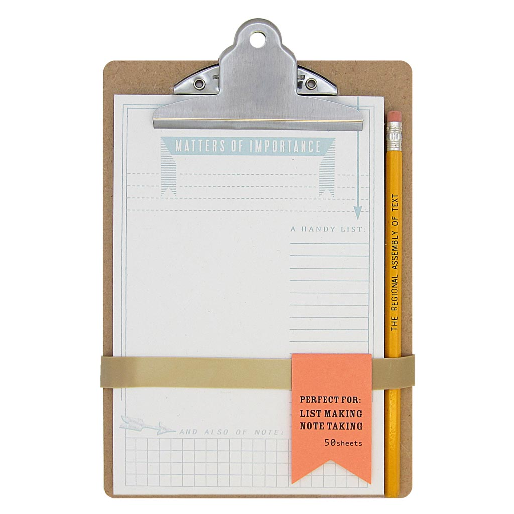 "This handy mini clipboard has a recycled notepad for list making and note taking.  Notepad is white and says Matters of Importance at the top in baby blue ink. The page is mostly blank, but has some little graph details at the bottom. Clipboard measures 6"" x 9"" and comes with an Assembly of Text pencil. Designed by The Regional Assembly of Text."