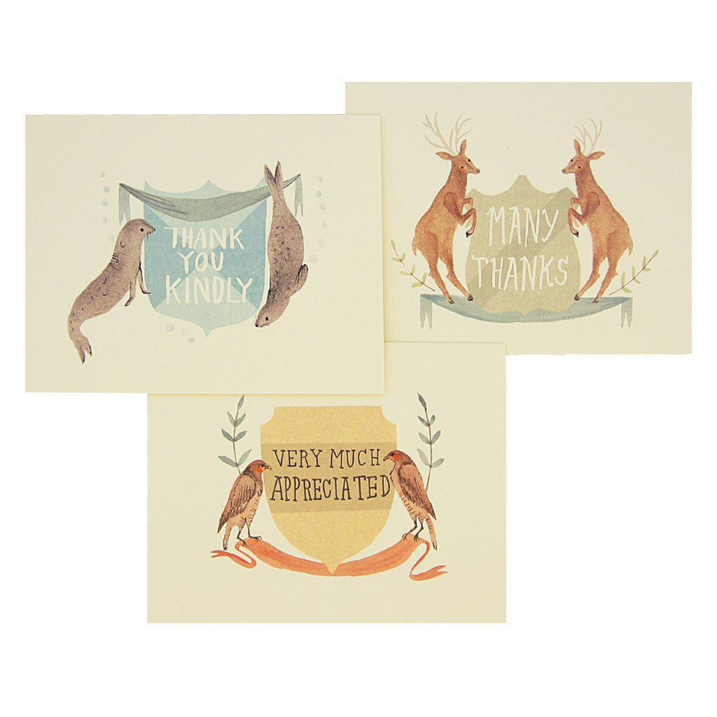 "Let these animals help you show your appreciation. There are three different designs of watercolour paintings of seals, deer and hawks. Each card features a set of animals on either side of a crest with a thank you greeting hand drawn inside the crest.Boxed set contains 12 assorted cards (blank inside) & 12 cream envelopes. Includes 4 of each design. Cards measure 4¼"" x 5½""."
