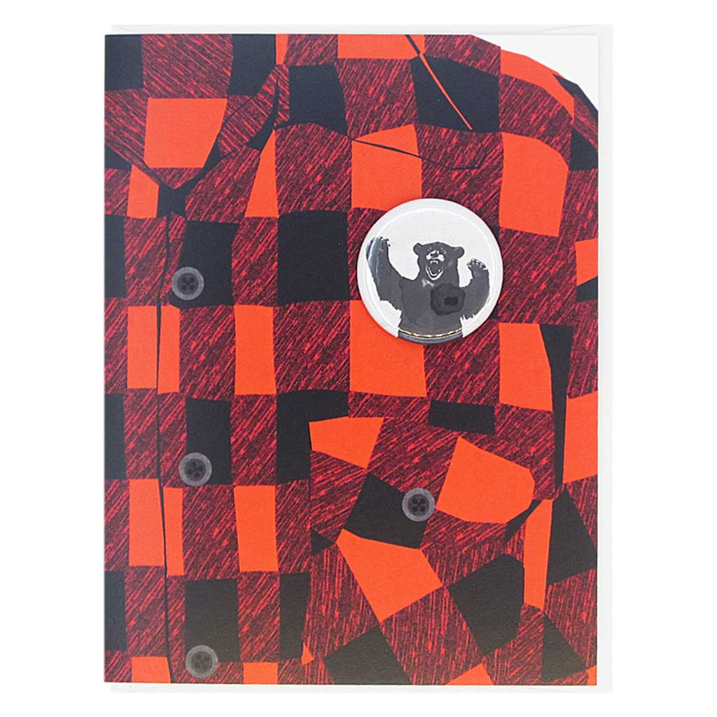 "This greeting card is a collage of a classic red and black flannel shirt with a button of a growling bear on the chest.  The button is 1¼"" and can be taken off and proudly worn by the recipient. Card measures 4¼"" x 5½"", comes with a white envelope & is blank inside. Designed by The Regional Assembly of Text."