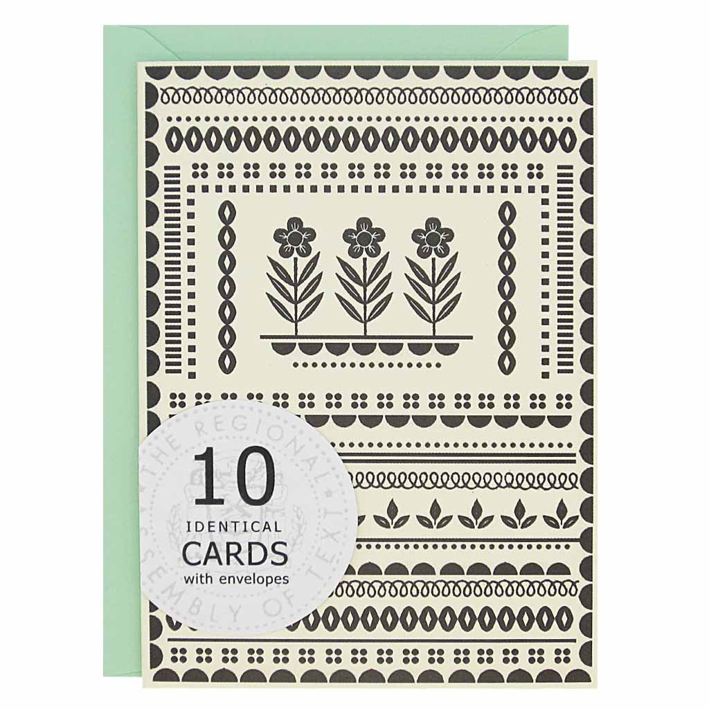 "These cards are perfect for any occasion. The cards have a black pattern with three flowers in the center on a cream coloured card. Boxed set contains 10 identical cards (blank inside) & 10 mint envelopes. Cards measure 3½""x 5"". Designed by The Regional Assembly of Text."