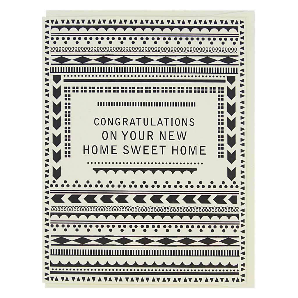 "This simple card has black geometric patterns on a cream coloured background with text in the middle that reads, 'Congratulations on Your New Home Sweet Home'. Measures 4¼"" x 5½"", comes with a cream envelope & is blank inside. Designed by The Regional Assembly of Text."