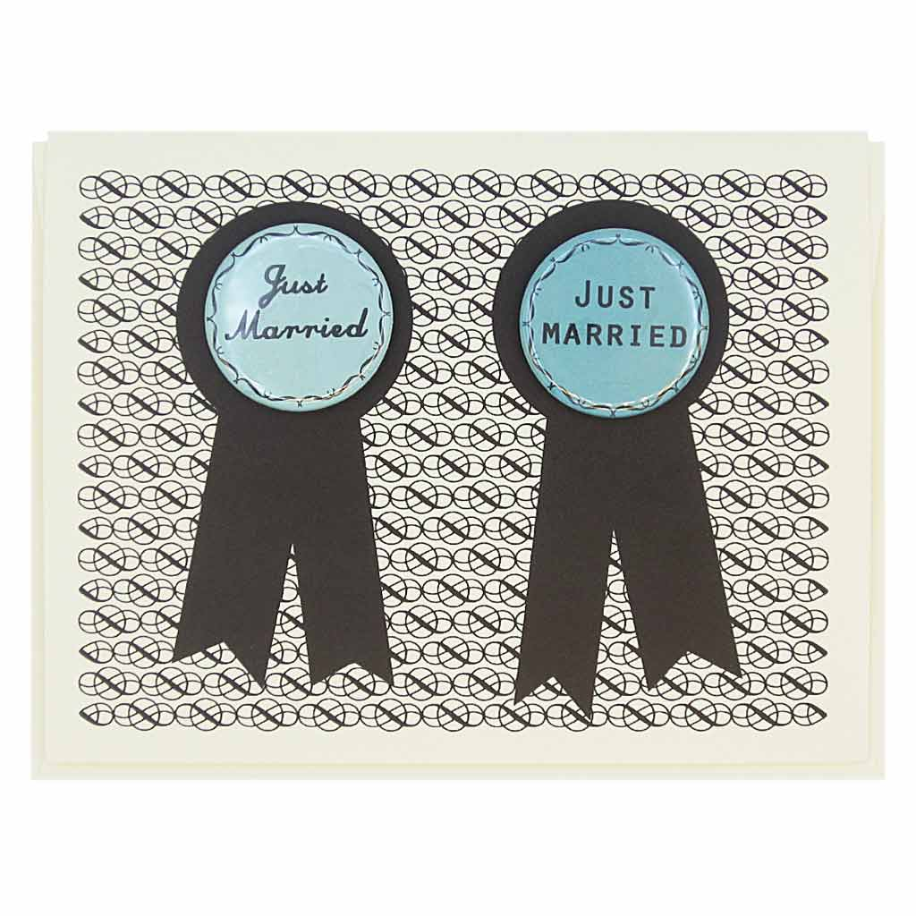 "This card has two prize ribbons side by sided and features two 1¼"" buttons that say 'Just Married' that can be taken off and worn by the recipients. Let us know during checkout if you need 2 new grandmas or 2 new grandpas instead. Card measures 4¼"" x 5½"", comes with a cream envelope & is blank inside. Designed by The Regional Assembly of Text."