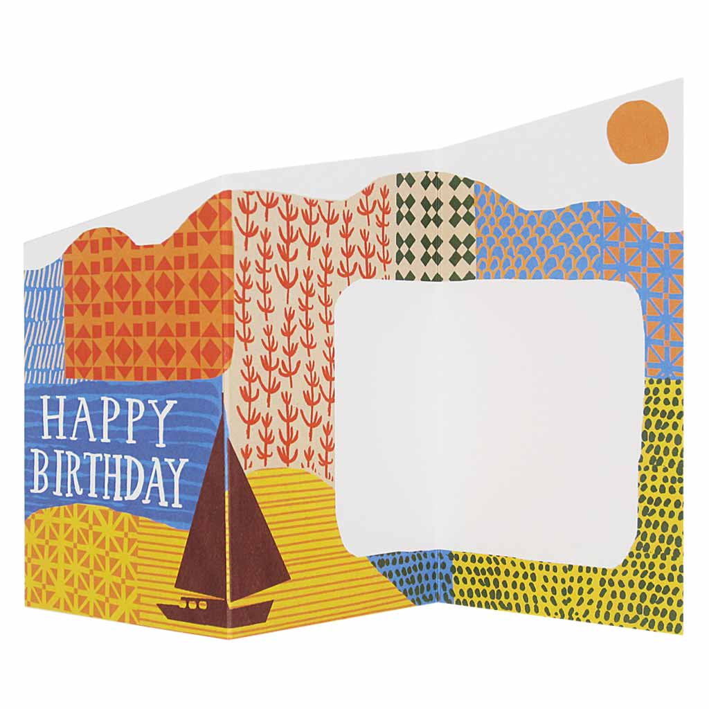 "This sweet little accordian birthday card unfolds into a pretty, colourful landscape with space to write a heartfelt message. Measures 3"" x 5½"" and comes with an orange envelope."