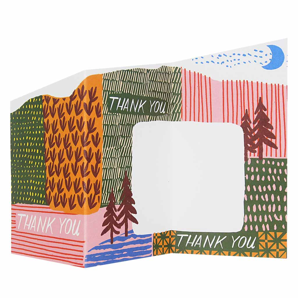 "This sweet little accordian thank you card unfolds into a pretty, colourful landscape with space to write a heartfelt message. Measures 3"" x 5½"" and comes with an orange envelope. Designed by The Regional Assembly of Text."