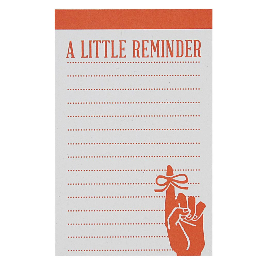 "Never forget a thing with this cute little notepad. Has a little orange image of a finger with a ribbon tied around it and the text ""A Little Reminder"". Measures 2½"" x 4″ and has approximately 50 pages of recycled paper. Designed by The Regional Assembly of Text."