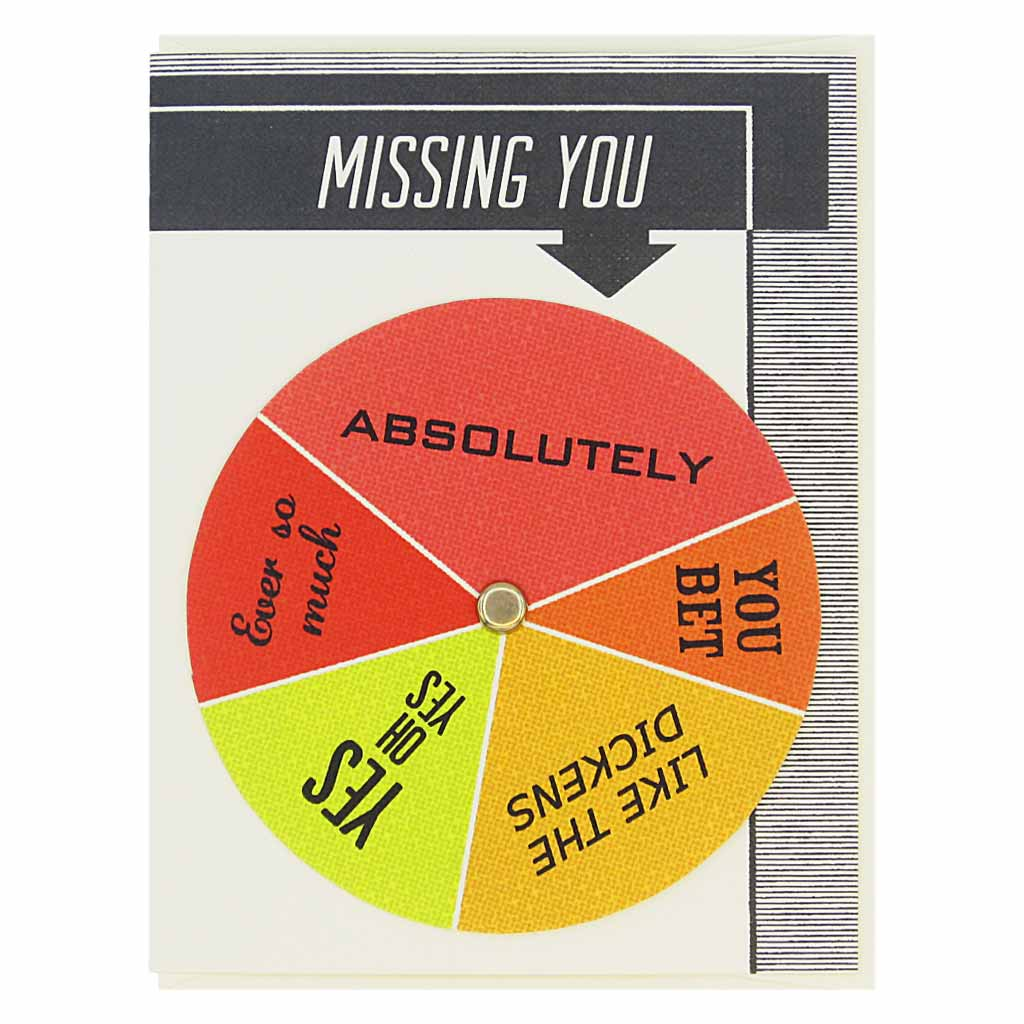 "This card has text at the top that says 'Missing You' and an arrow pointing to a colourful wheel that you can spin to select different sentiments including… 'Ever so Much, Yes Oh Yes, Absolutely'. Card measures 4¼"" x 5½"", comes with a cream envelope & is blank inside. Designed by The Regional Assembly of Text."