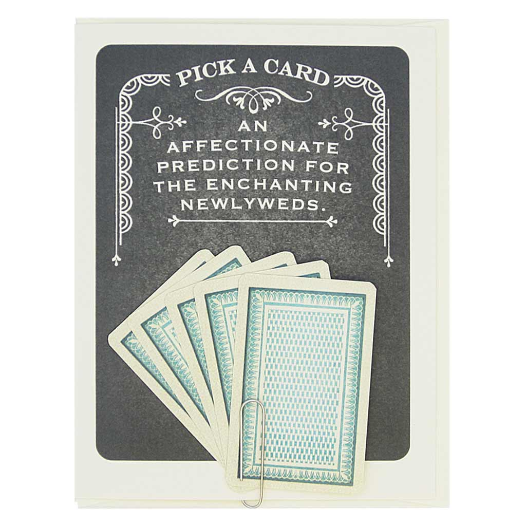 "This card says Pick A Card… An Affectionate Prediction for the Enchanting Newlyweds, and has 5 tiny playing cards to choose from attached to the front of the card with a paperclip. Pick one to reveal the future. All fortunes are bright and cheery. Card measures 4¼"" x 5½"", comes with a cream envelope & is blank inside. Designed by The Regional Assembly of Text."