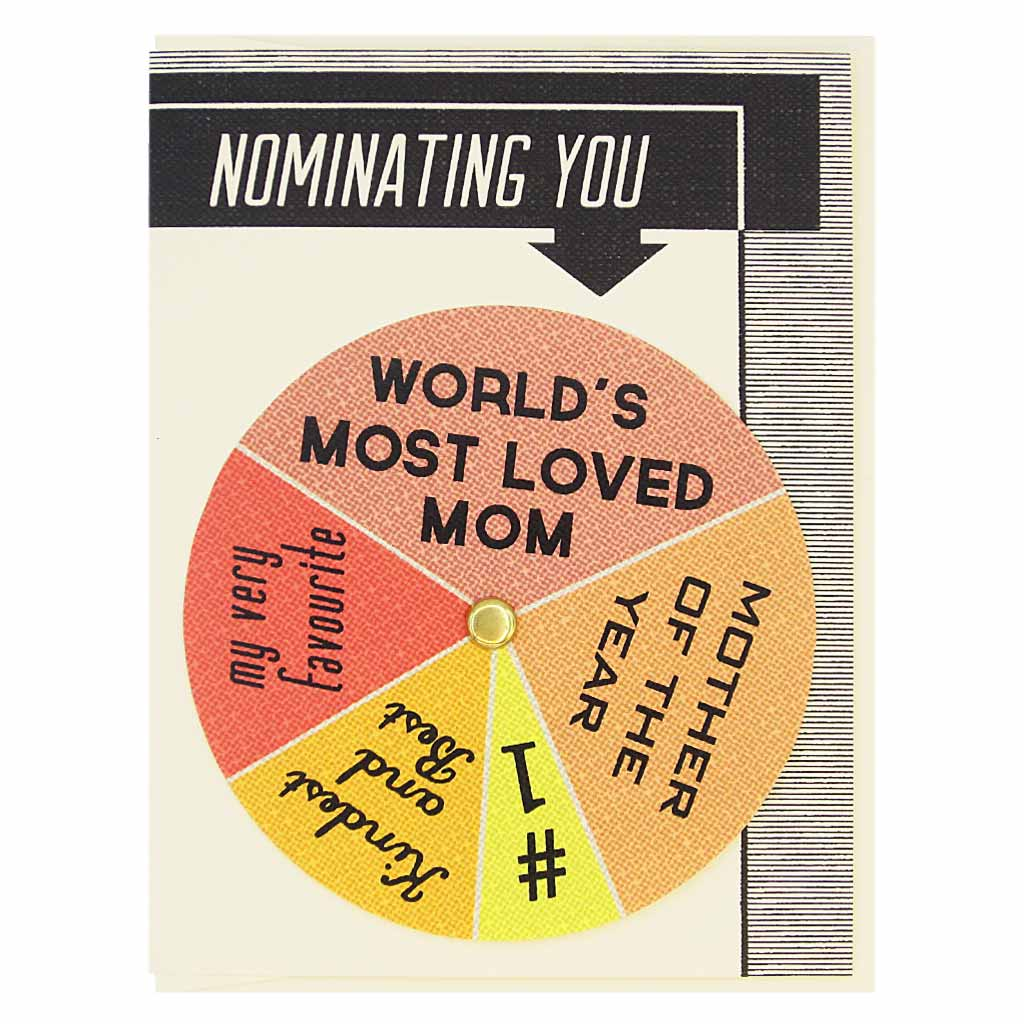 "his Mother's Day card has text at the top that says 'Nominating You' and an arrow pointing to a colourful wheel that you can spin to select different sentiments including…#1 Mom, Kindest & Best, World's Most Loved Mom'. Card measures 4¼"" x 5½"", comes with a cream envelope & is blank inside. Designed by The Regional Assembly of Text."
