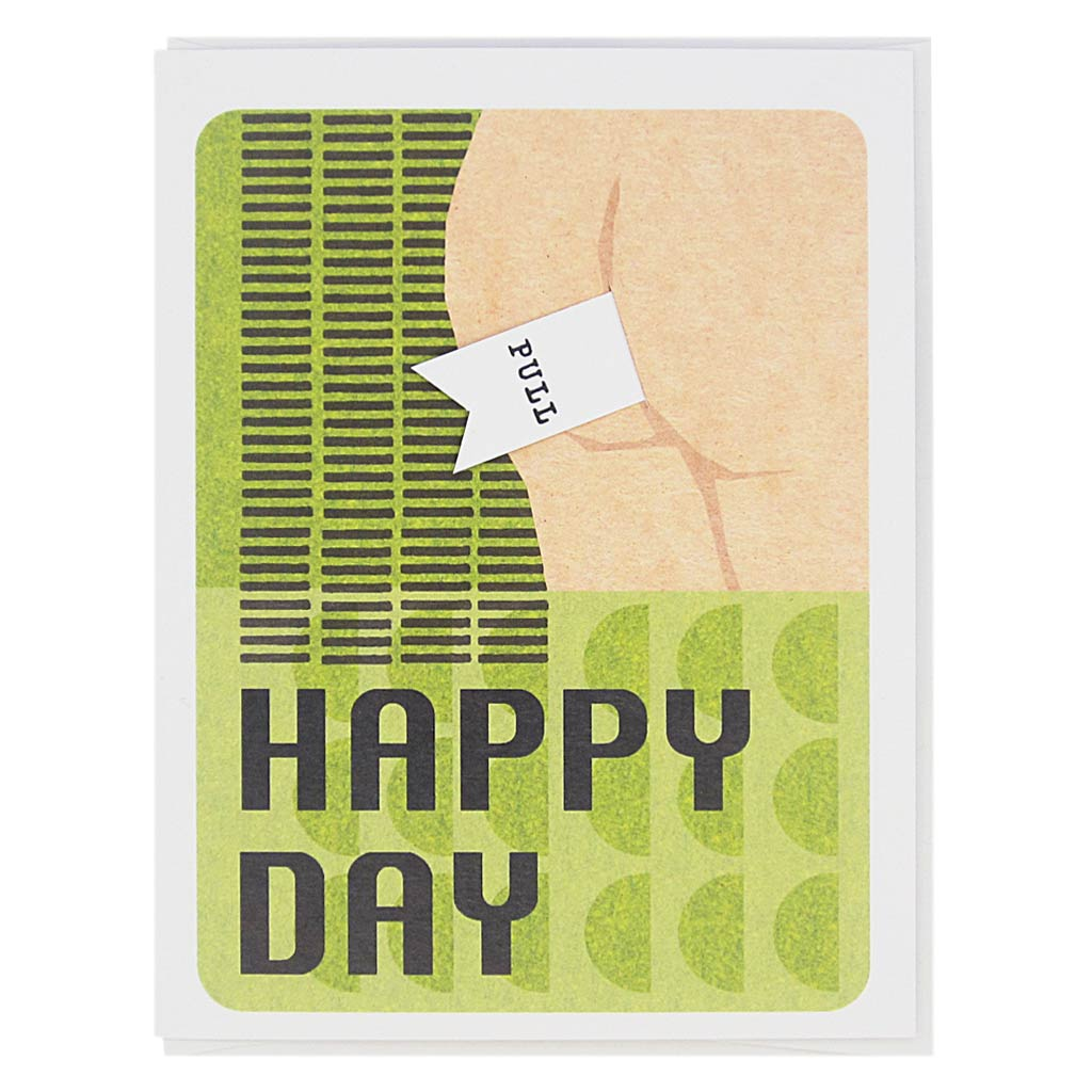 "This card features a collage of a bum on a 60's inspired background and the text reads 'Happy Day'. There is a pull tab on the card coming out of the bum and when you pull it the text reads 'Old Fart'. Measures 4¼"" x 5½"", comes with a white envelope & is blank inside. Designed by The Regional Assembly of Text."
