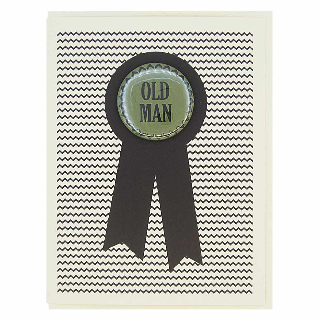 "This popular birthday card is sure to make someone chuckle. Or offend them! This birthday card looks like a prize ribbon. Features a 1½"" button with the text 'Old Man' that can be taken off and proudly worn by the recipient. Card measures 4¼"" x 5½"", comes with a cream envelope & is blank inside. Designed by The Regional Assembly of Text."
