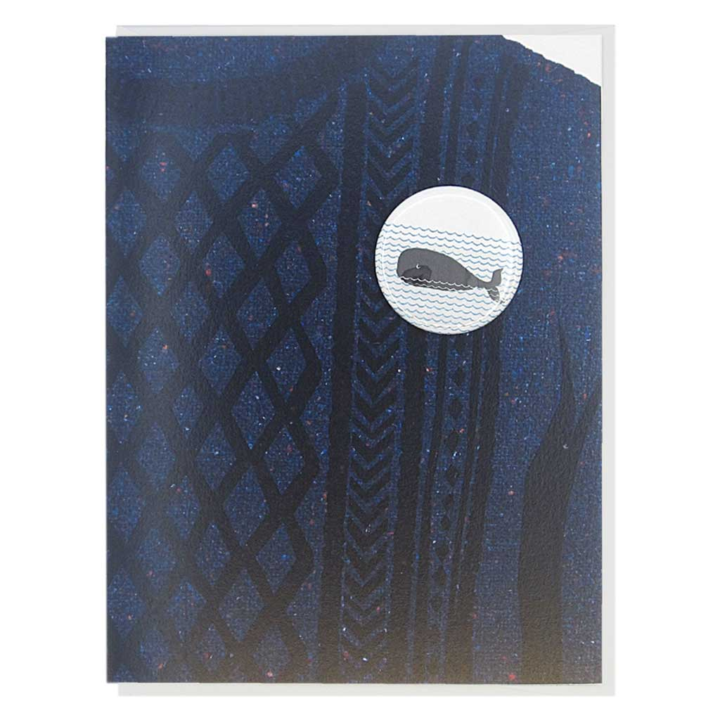 "This greeting card is a collage of a navy cable knit sweater with a button of a whale on the chest.  The button is 1¼"" and can be taken off and proudly worn by the recipient. Card measures 4¼"" x 5½"", comes with a white envelope & is blank inside. Designed by The Regional Assembly of Text."