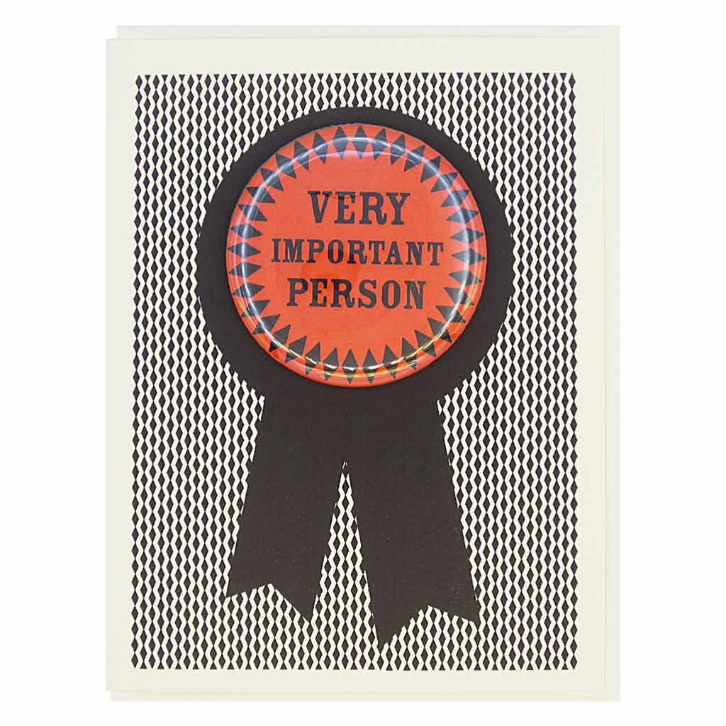 "This greeting card looks like a prize ribbon. Features a 2¼"" button with the text 'Very Important Person' that can be taken off and proudly worn by the recipient. Card measures 4¼"" x 5½"", comes with a cream envelope & is blank inside. Designed by The Regional Assembly of Text."