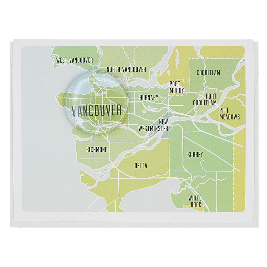"This greeting card is a blue, green and yellow map of The Lower Mainland with a 1½"" button of Vancouve B.C. Card measures 4¼"" x 5½"", comes with a white envelope & is blank inside. Designed by The Regional Assembly of Text."