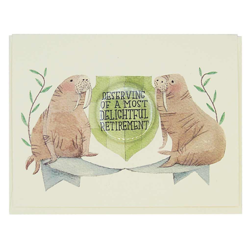 "This beautiful retirement card features a watercolour painting of two walruses on either side of a crest. There is a 1½"" button in the middle of the crest that reads 'Deserving a Most Delightful Retirement'. The button can be taken off and worn by the recipient. Card measures 4¼"" x 5½"", comes with a cream envelope & is blank inside. Designed by The Regional Assembly of Text."