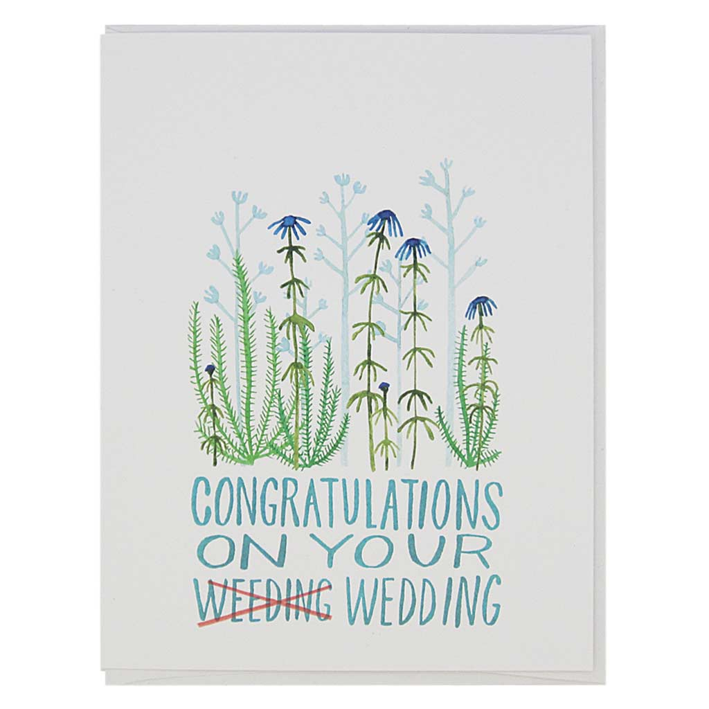 "This wedding card is a very punny card. It is a beautiful watercolour painting of some flowers and the hand drawn text reads 'Congratulations on your Weeding, I mean Wedding'. Measures 4¼"" x 5½"", comes with a white envelope & is blank inside. Designed by The Regional Assembly of Text."