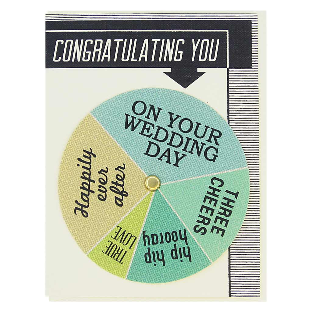 "This wedding card has text at the top that says 'Congratulating You' and an arrow pointing to a colourful wheel that you can spin to select different sentiments including…'Happily Ever After, Hip Hip Hooray, True Love'. Card measures 4¼"" x 5½"", comes with a cream envelope & is blank inside. Designed by The Regional Assembly of Text."
