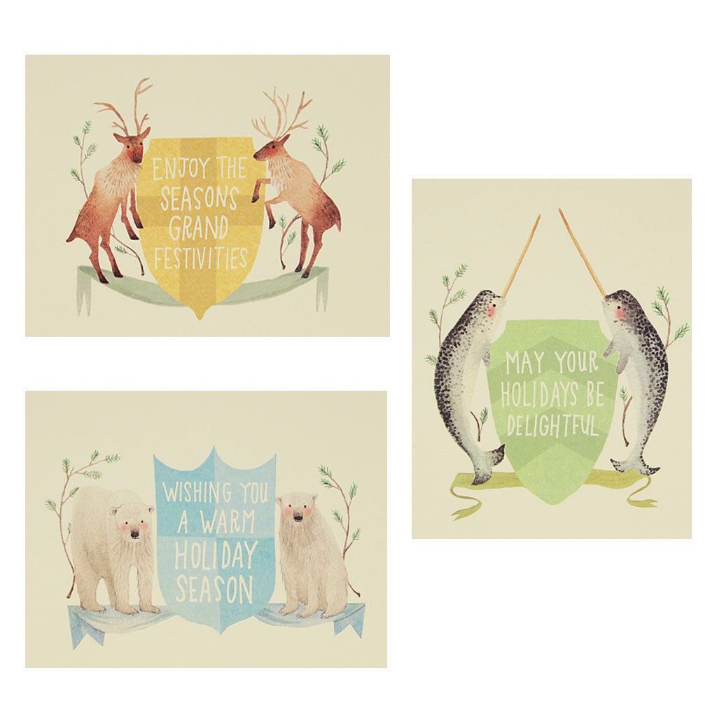 "Let these animals help you spread some cheer. Animals are watercolour paintings of reindeer, polar bears and narwhal in the form of crests with holiday wording. Boxed set contains 12 assorted cards (blank inside) & 12 cream envelopes. Includes 4 of each design. Cards measure 4¼"" x 5½""."